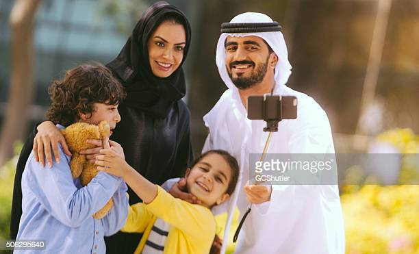 Arab Family taking selfie in a park