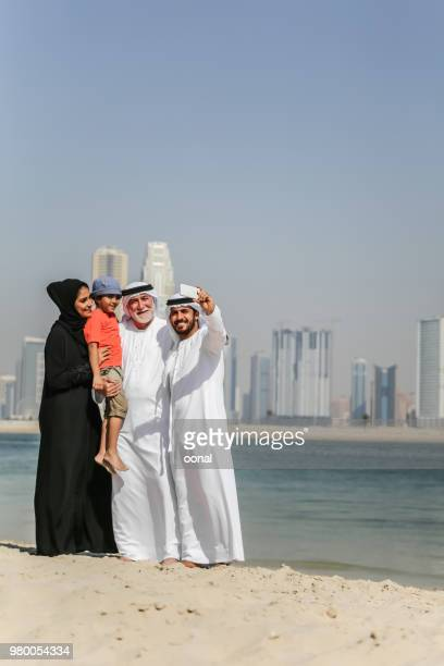 arab family taking selfie on the autumn beach - two generation family stock pictures, royalty-free photos & images