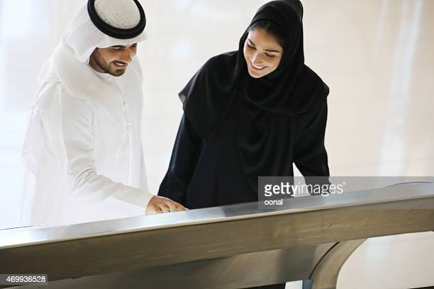 arab family using interactive screen of digital kiosk - touch sensitive stock pictures, royalty-free photos & images