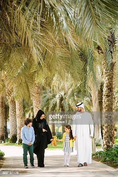 Arab Family Walking in Park