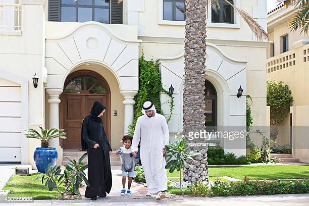 arab family walking outdoors on a sunny day - house stock pictures, royalty-free photos & images