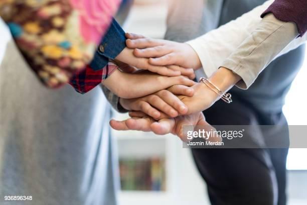 arab family with hands in circle - mani incrociate foto e immagini stock