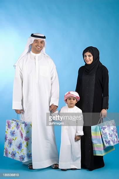 Arab family with shopping bags