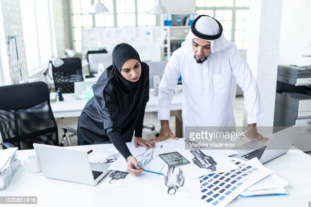 Arab fashion designers discussing new models at work