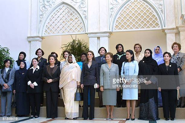 Arab First Ladies and heads of delegations to the second Arab Woman's Summit pose for a group photograph 03 November 2002 in Amman Buthina Sharbat of...