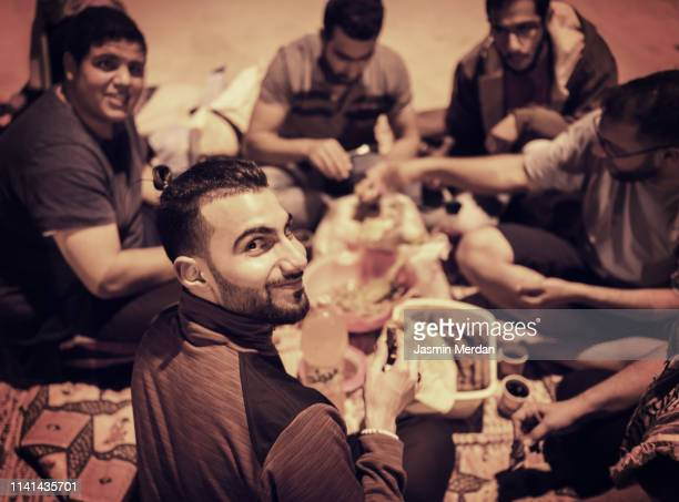 arab friends having barbecue - iftar stock pictures, royalty-free photos & images
