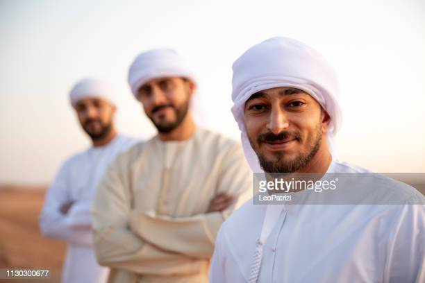 arab friends out of dubai desert for a weekend - remote location stock pictures, royalty-free photos & images