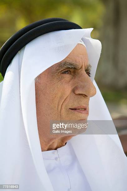 Arab Grandfather Standing in Park Looking into the Distance. Dubai, United Arab Emirates