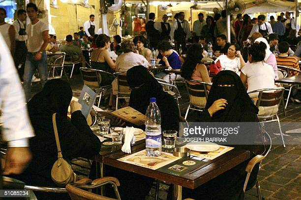 Arab Gulf women sit at a restaurant in downtown Beirut 20 July 2004 Tourism has been on the rise since the end of Lebanon's 19751990 civil war...