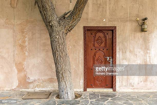 arab house front door - uae heritage stock photos and pictures