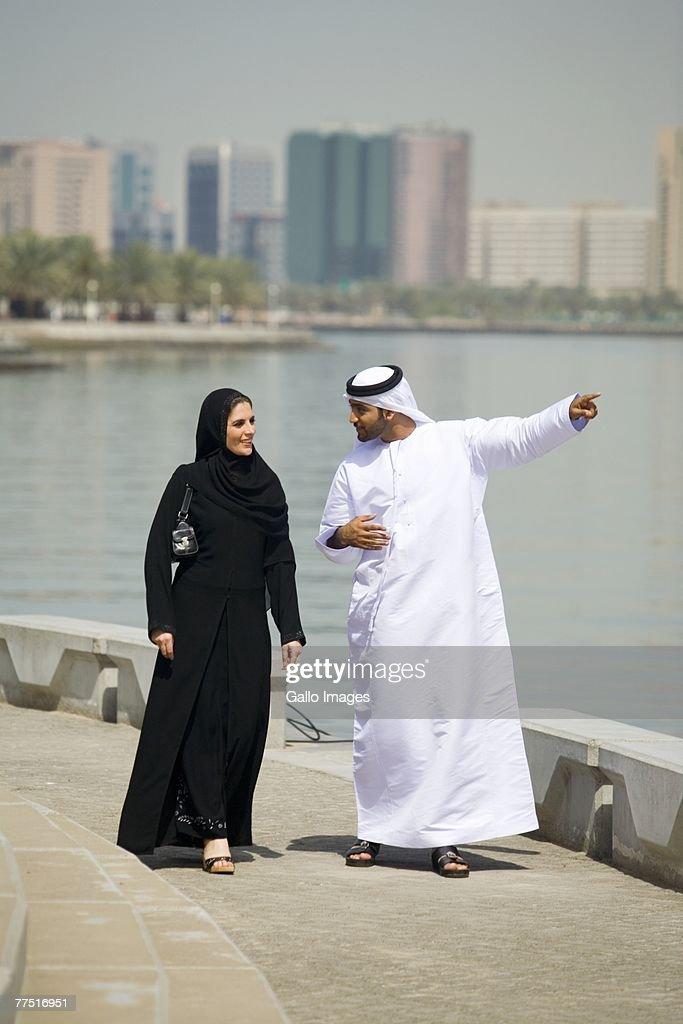 Arab Husband And Wife Walking Along Water Dubai United ...