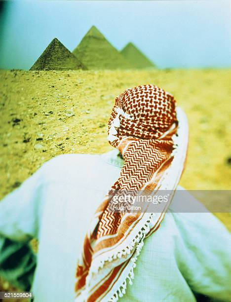 arab in front of the pyramids of giza, egypt - hugh sitton stock pictures, royalty-free photos & images