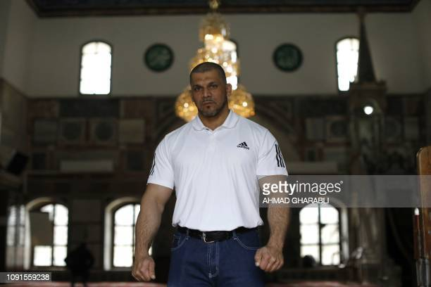 Arab Israeli bodybuilder and Muezzin Ibrahim Masri is pictured at elJazzar mosque in the northern Israeli port city of Acre on January 29 2019 Masri...