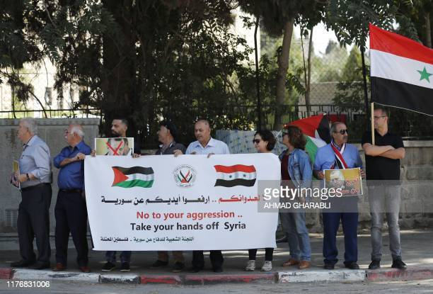 Arab Israeli Druze protesters gather outside Turkey's consulate in Jerusalem on October 19, 2019 to protest against the Turkish military operation in...