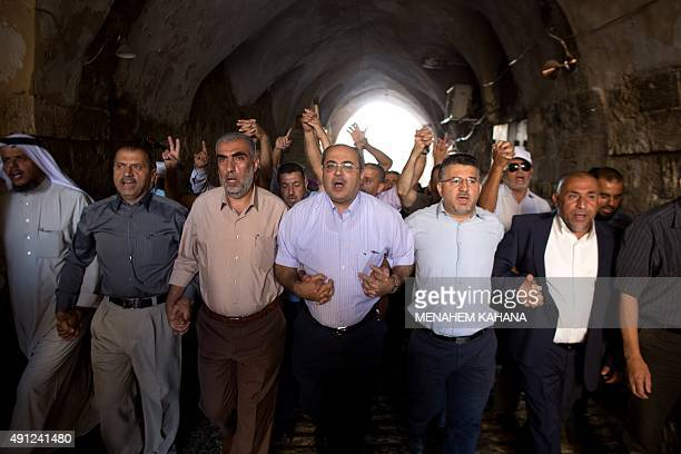 Arab Israeli Knesset member Ahmad Tibi takes part in a demonstration alongside a group of Palestinians in a street in the Muslim quarter of...