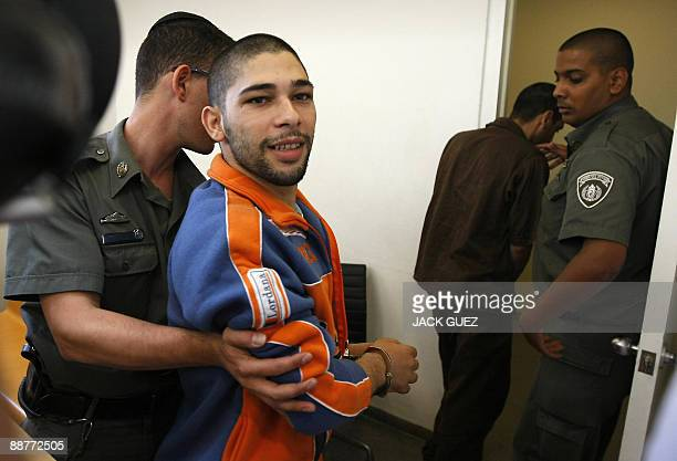 Arab Israeli Munir Zaqut one of the seven men indicted for lynching an Israeli soldier after he shot dead four people is escorted by policemen at the...