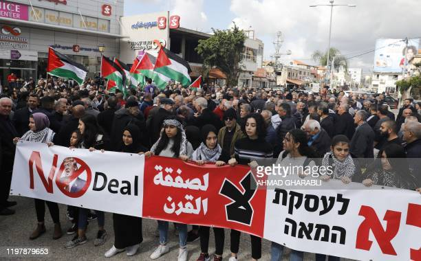 Arab Israelis take part in a rally to express their opposition to the USbrokered proposal for a settlement of the Middle East conflict in the...