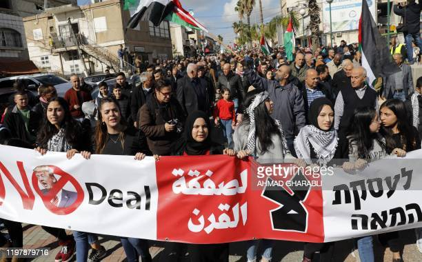 Arab Israelis take part in a rally to express their opposition to the US-brokered proposal for a settlement of the Middle East conflict, in the...