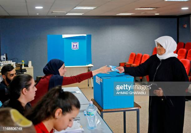 Arab Israelis votes during Israel's parliamentary election at a polling station in Kafr Manda near Haifa on September 17 2019