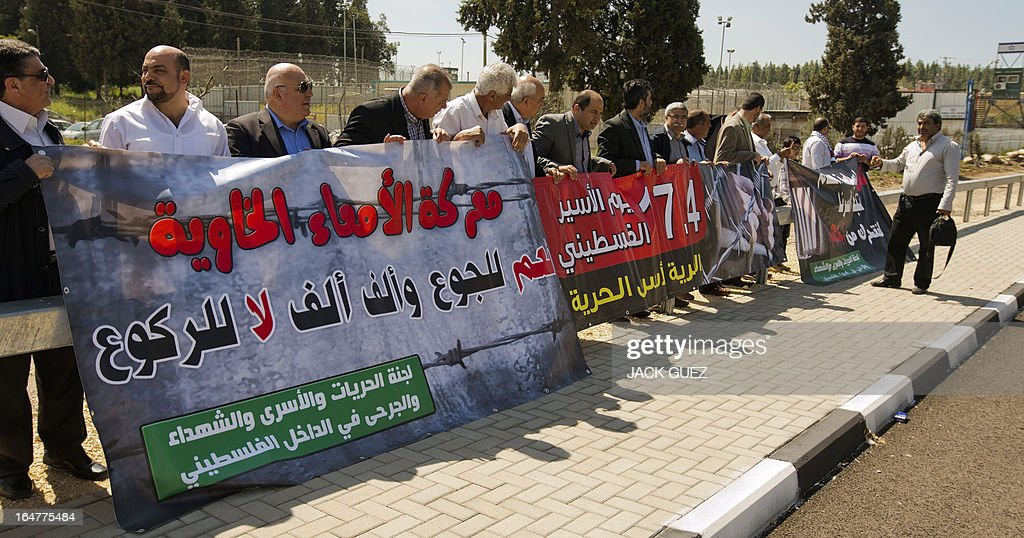 Arab Knesset Member's and community leaders carry placards as they protest outside the Megiddo Prison in northern Israel, demanding the release of administrative prisoners on March 28, 2013.