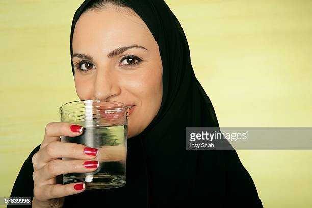 Arab lady with a glass of water.