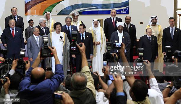 Arab leaders pose for a group picture during the opening session of the Arab League Extraordinary Summit in the Libyan coastal city of Sirte on...