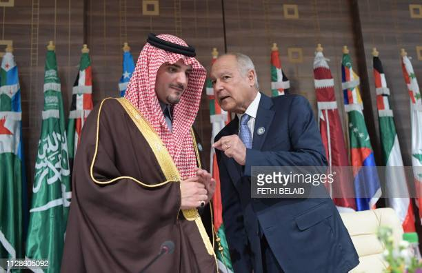 Arab League chief Ahmed Aboul Gheit speaks with Saudi Minister of Interior Abdulaziz bin Saud alSaud during the opening session of a meeting of Arab...