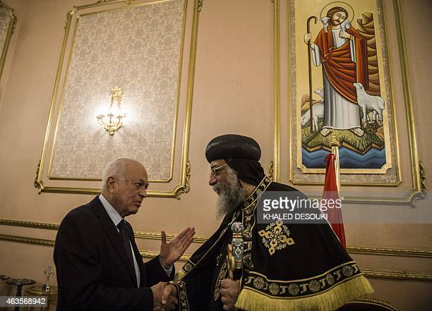 Arab League general secretary Nabil alArabi offers his condolences to Egypt's Coptic Pope Tawadros II at SaintMark's Coptic Cathedral in Cairo's...