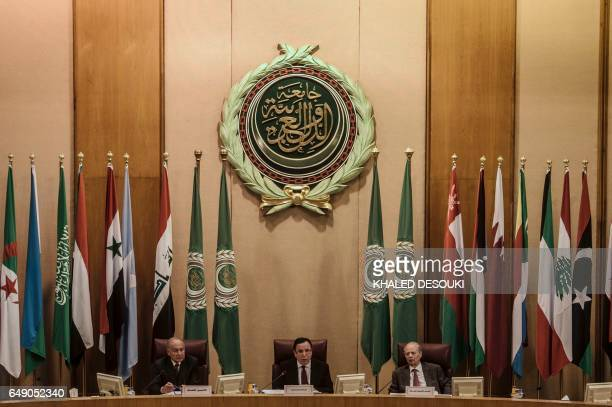Arab League Secretary General Ahmed AbulGheit Tunisian Foreign Minister Khemaies Jhinaoui and Arab League Deputy Secretary General Ahmed Ben Helli...