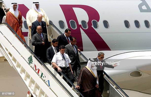 Arab League Secretary General Amr Mussa gestures as he walks down from a plane with Qatari Premier and Foreign Minister Sheikh Hamad bin Jassem...