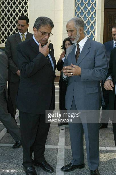 Arab League Secretary General Amr Mussa listens to Algerian Foreign Minister Abdelaziz Belkhadem after their joint press conference in Cairo 12...