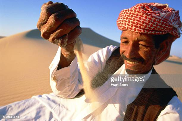 Arab lying satisfied in the desert