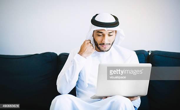 Arab Man Browsing Online at Home