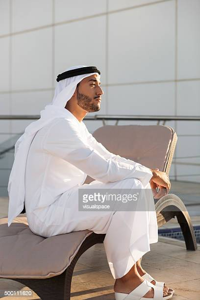 Arab Man Day Dreaming On A Beachchair