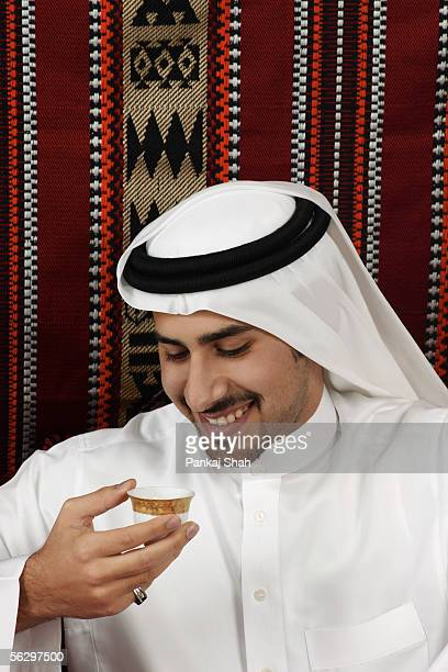 arab man drinks tea - majlis stock pictures, royalty-free photos & images
