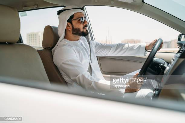 arab man in the car in the city - one man only stock pictures, royalty-free photos & images