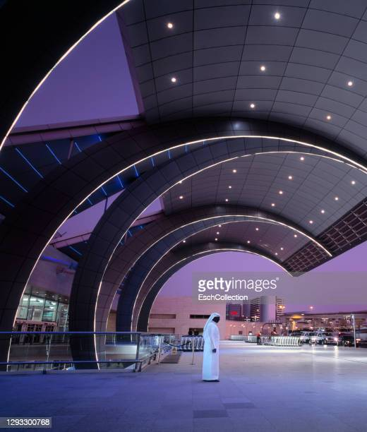arab man in traditional robe at dubai international airport, uae - middle east stock pictures, royalty-free photos & images