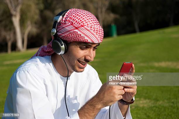 Arab man listening to music