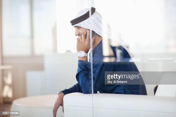 arab man talking on mobile phone. - kaffiyeh stock pictures, royalty-free photos & images