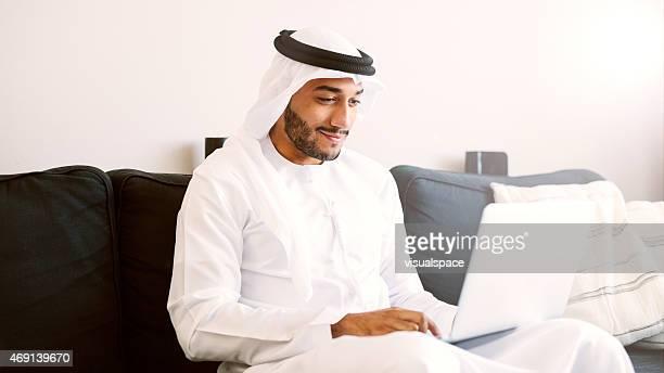 Arab Man Using Laptop
