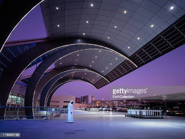 Arab man waiting at Dubai International Airport