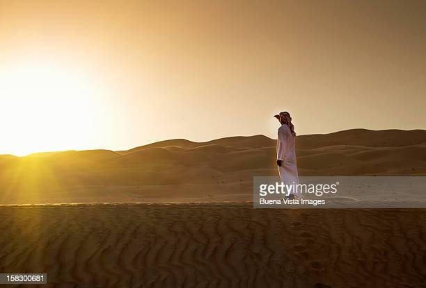 Arab man watching sun setting