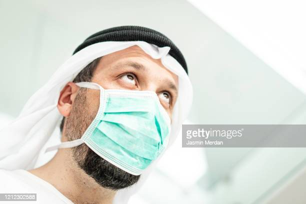 arab man with mask against corona virus - gulf countries stock pictures, royalty-free photos & images