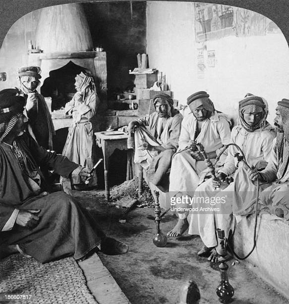 Arab men at their leisure in a coffee house Mosul Iraq late 1890s or early 1900s