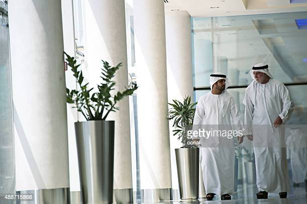 arab men in hall - bahrain national day stock photos and pictures