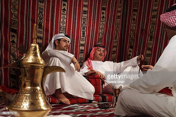 arab men on a tea session - majlis stock pictures, royalty-free photos & images