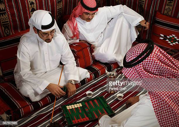 arab men playing a board game - majlis stock pictures, royalty-free photos & images
