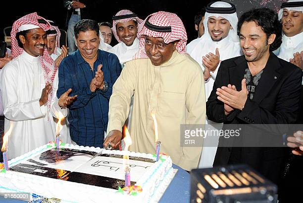 Arab Musicians Applaud As Saudi Singer Abdel Rab Idriss Cuts A Cake During The Launching Ceremony