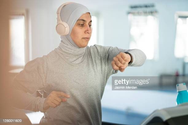 arab muslim women working out in gym - united arab emirates stock pictures, royalty-free photos & images