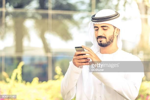 Arab National woking on his smartphone